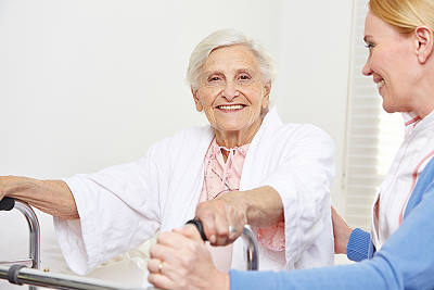 Aide from Paradise Home Health Care assisting elderly woman